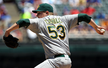 ARLINGTON, TX - JULY 10:  Trevor Cahill #53 of the Oakland Athletics throws against the Texas Rangers in the first inning at Rangers Ballpark in Arlington on July 10, 2011 in Arlington, Texas.  (Photo by Ronald Martinez/Getty Images)