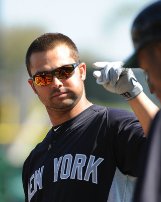 CLEARWATER, FL - FEBRUARY 27:  Outfielder Nick Swisher #33 of the New York Yankees takes batting practice before play against the Philadelphia Phillies February 27, 2011 at Bright House Field in Clearwater, Florida.  (Photo by Al Messerschmidt/Getty Image