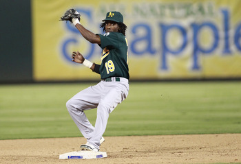ARLINGTON, TX - JULY 7: Jemile Weeks #19 of the Oakland Athletics makes the out on the forced run and the throw to first base for a double play against the Texas Rangers at Rangers Ballpark in Arlington on July 7, 2011 in Arlington, Texas. (Photo by Rick