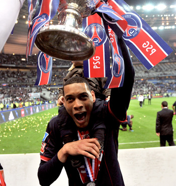 PARIS - MAY 01: Paris Saint-Germain's French striker Guillaume Hoarau holds the trophy as he celebrates the winning of the French Cup final between Paris Saint Germain football club and A.S Monaco at Stade de France on May 1, 2010 in Paris, France. Paris