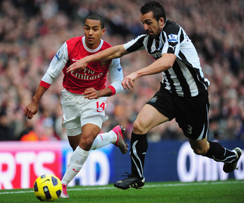 LONDON, ENGLAND - NOVEMBER 07:  Theo Walcott of Arsenal tries to get past Jose Enrique of Newcastle during the Barclays Premier League match between Arsenal and Newcastle United at the Emirates Stadium on November 7, 2010 in London, England.  (Photo by Mi
