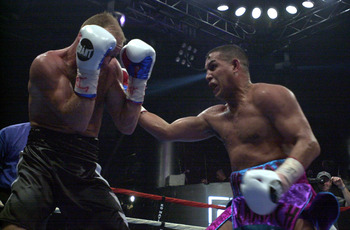 03 Feb 2001:  Hector Camacho Sr. (right) throws a punch at Troy Lowry during the fifth round of their Middleweight Bout during Mucho Macho Madness at the Level Club in Miami, Florida. Camacho won with a 10-round decision.  DIGITAL IMAGE  Mandatory Credit: