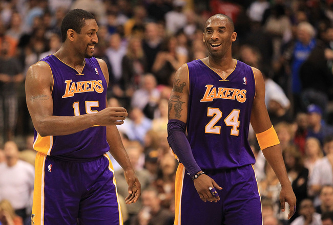 DALLAS, TX - MARCH 12:  Kobe Bryant #24 and Ron Artest #15 of the Los Angeles Lakers react after a 96-91 win against the Dallas Mavericks at American Airlines Center on March 12, 2011 in Dallas, Texas.  NOTE TO USER: User expressly acknowledges and agrees