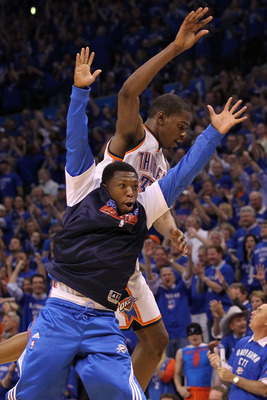 OKLAHOMA CITY, OK - MAY 23:  Nate Robinson #3 and Kevin Durant #35 of the Oklahoma City Thunder react as Durant comes towards the bench in the fourth quarter against the Dallas Mavericks in Game Four of the Western Conference Finals during the 2011 NBA Pl