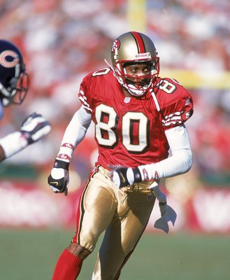 17 Dec 2000:  Jerry Rice #80 of the San Francisco 49ers looks to the side while running during the game against the Chicago Bears at the 3Com Park in San Francisco, California. The 49ers defeated the Bears 17-0.Mandatory Credit: Jed Jacobsohn  /Allsport