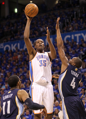 OKLAHOMA CITY, OK - MAY 03:  Forward Kevin Durant #35 of the Oklahoma City Thunder takes a shot against Mike Conley #11 and Sam Young #4 of the Memphis Grizzlies in Game Two of the Western Conference Semifinals in the 2011 NBA Playoffs on May 3, 2011 at O