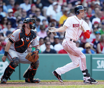 BOSTON, MA - JULY 10:  Jacoby Ellsbury #2 of the Boston Red Sox gets a hit as Matt Wieters #32 of the Baltimore Orioles catches on July 10, 2011 at Fenway Park in Boston, Massachusetts.The Boston Red Sox defeated the Baltimore Orioles 8-6.  (Photo by Elsa