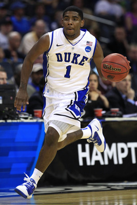 CHARLOTTE, NC - MARCH 18:  Kyrie Irving #1 of the Duke Blue Devils moves the ball in the second half while taking on the Hampton Pirates during the second round of the 2011 NCAA men's basketball tournament at Time Warner Cable Arena on March 18, 2011 in C