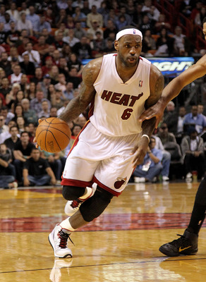 MIAMI, FL - FEBRUARY 08: LeBron James #6 of the Miami Heat dribbles in the lane during a game against the Indiana Pacers at American Airlines Arena on February 8, 2011 in Miami, Florida. NOTE TO USER: User expressly acknowledges and agrees that, by downlo