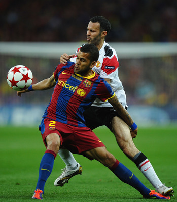 Dani Alves, shows his class holding off Ryan Giggs