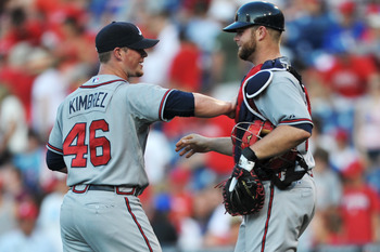 PHILADELPHIA, PA - JULY 09: Craig Kimbrel #46 and Brian McCann #16 of the Atlanta Braves congratulate each other after beating the Philadelphia Phillies 4-1 at Citizens Bank Park on July 9, 2011 in Philadelphia, Pennsylvania. (Photo by Drew Hallowell/Gett