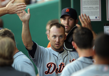 KANSAS CITY, MO - JULY 09:  Ryan Raburn #25 of the Detroit Tigers is congratulated in the dugout after scoring during the game against the Kansas City Royals on July 9, 2011 at Kauffman Stadium in Kansas City, Missouri.  (Photo by Jamie Squire/Getty Image