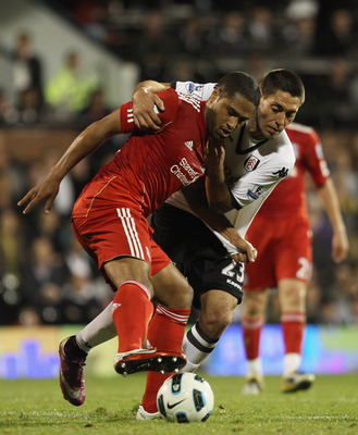 LONDON, ENGLAND - MAY 09:  Glen Johnson of Liverpool fights for the ball with Clint Dempsey of Fulham during the Barclays Premier League match between Fulham and Liverpool at Craven Cottage on May 9, 2011 in London, England.  (Photo by Scott Heavey/Getty
