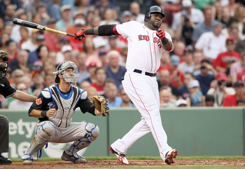 BOSTON, MA - JULY 05:  David Ortiz #34 of the Boston Red Sox hits a double in the second inning as J.P. Arencibia #9 of the Toronto Blue Jays catches on July 5, 2011 at Fenway Park in Boston, Massachusetts.  (Photo by Elsa/Getty Images)