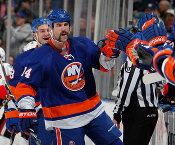 UNIONDALE, NY - JANUARY 13:  Trevor Gillies #14 of the New York Islanders celebrates scoring a goal in the first period of an NHL hockey game against the Ottawa Senators at the Nassau Coliseum on January 13, 2011 in Uniondale, New York.  (Photo by Paul Be