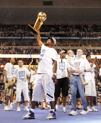 DALLAS, TX - JUNE 16: Guard Jason Terry of the Dallas Mavericks raises the Larry O'Brien Trophy for fans during the Dallas Mavericks Victory celebration on June 16, 2011 in Dallas, Texas. (Photo by Brandon Wade/Getty Images)