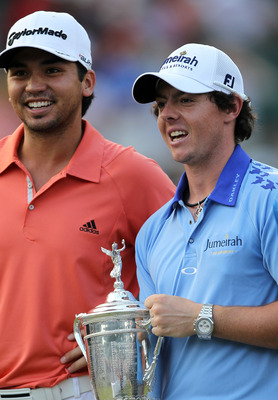 BETHESDA, MD - JUNE 19:  Rory McIlroy of Northern Ireland poses with the trophy after his eight-stroke victory on the 18th green alongside runner-up Jason Day of Australia during the 111th U.S. Open at Congressional Country Club on June 19, 2011 in Bethes