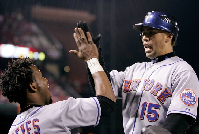 ST LOUIS - OCTOBER 15:  Carlos Beltran #15 with Jose Reyes of the New York Mets celebrates after hitting a solo home run in the seventh inning against the St. Louis Cardinals during game four of the NLCS at Busch Stadium on October 15, 2006 in St. Louis,