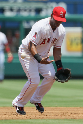 ANAHEIM, CA - JULY 06:  Third baseman Alberto Callaspo #6 of the Los Angeles Angels of Anaheim bobbles a ball hit by Jhonny Peralta of the Detroit Tigers in the second inning at Angel Stadium of Anaheim on July 6, 2011 in Anaheim, California. The Tigers d