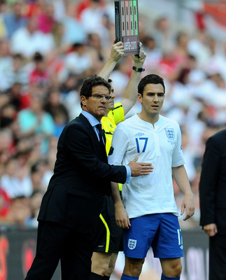 LONDON, ENGLAND - JUNE 04:  England Manager Fabio Capello sends on Stewart Downing as a substitute during the UEFA EURO 2012 group G qualifying match between England and Switzerland at Wembley Stadium on June 4, 2011 in London, England.  (Photo by Clive M