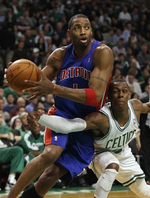 BOSTON, MA - JANUARY 19:  Tracy McGrady #1 of the Detroit Pistons tries to keep the ball from Rajon Rondo of the Boston Celtics on January 19, 2011 at the TD Garden in Boston, Massachusetts. The Celtics defeated the Pistons 86-82. NOTE TO USER: User expre