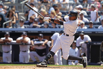 NEW YORK, NY - JULY 10:  Curtis Granderson #14 of the New York Yankees against the Tampa Bay Rays at Yankee Stadium on July 10, 2011 in the Bronx borough of New York City.  (Photo by Nick Laham/Getty Images)