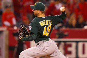 ANAHEIM, CA - MAY 23:  Michael Wuertz #48 of the Oakland Athletics pitches in the eighth inning during the game against the Los Angeles Angels of Anaheim at Angel Stadium on May 23, 2011 in Anaheim, California.  (Photo by Joe Scarnici/Getty Images)