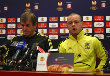 LIVERPOOL, ENGLAND - MARCH 16:  Liverpool manager Kenny Dalglish listens as Jay Spearing answers a question during a press conference ahead of their UEFA Europa League Round of 16 second leg match against Braga at Melwood Training Ground on March 16, 2010