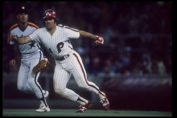 Infielder Pete Rose of the Philadelphia Phillies runs off the base as infielder Art Howe of the Houston Astros watches during a game at Veterans Stadium in Philadephia, Pennsylvania.