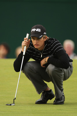 SANDWICH, ENGLAND - JULY 14:  Tom Lewis of England lines up a putt on the 18th green during the first round of The 140th Open Championship at Royal St George's on July 14, 2011 in Sandwich, England.  (Photo by Ross Kinnaird/Getty Images)