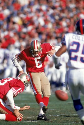 SAN FRANCISCO - JANUARY 15:  Mike Cofer #6 of the San Francisco 49ers kicks the ball during the 1993 NFC Divisional Playoff game against the New York Giants at Candlestick Park on January 15, 1994 in San Francisco, California.  The 49ers won 44-3.  (Photo