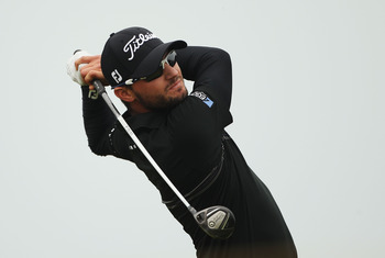 SANDWICH, ENGLAND - JULY 14:  Kyle Stanley of the United States tees off on the 17th hole during the first round of The 140th Open Championship at Royal St George's on July 14, 2011 in Sandwich, England.  (Photo by Andrew Redington/Getty Images)