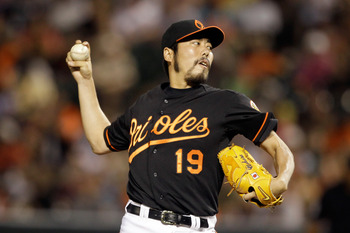 BALTIMORE, MD - JUNE 24: Relief pitcher Koji Uehara #19 of the Baltimore Orioles delivers to a Cincinnati Reds batter during the twelfth inning at Oriole Park at Camden Yards on June 24, 2011 in Baltimore, Maryland. The Orioles defeated the Red 5-4.  (Pho