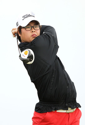 SANDWICH, ENGLAND - JULY 13:  Jung-Gon Hwang of South Korea tees off during the final practice round during The Open Championship at Royal St. George's on July 13, 2011 in Sandwich, England. The 140th Open begins on July 14, 2011.. (Photo by Andrew Reding