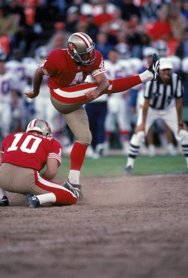 SAN FRANCISCO - AUGUST 12:  Doug Brien #4 of the San Francisco 49ers kicks the ball during a preseason game against the Denver Broncos at Candlestick Park on August 12, 1994 in San Francisco, California.  The 49ers won 20-3.  (Photo by George Rose/Getty I