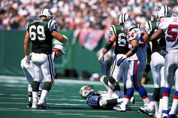 12 Sep 1999: Vinny Testaverde #16 of the New York Jets falls as he grabs his leg in pain during a game against the New England Patriots at the Giants Stadium in East Rutherford, New Jersey. The Patriots defeated the Jets 30-28. Mandatory Credit: Ezra O. S