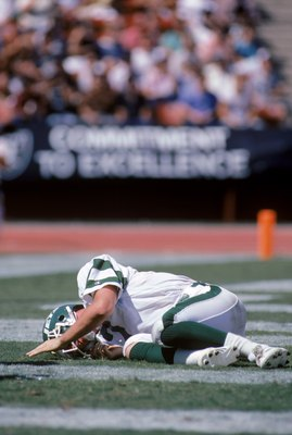 LOS ANGELES, CA - SEPTEMBER 8:  Quarterback Ken O'Brien #7 of the New York Jets needs a moment to get up during a game against the Los Angeles Raiders at the Los Angeles Memorial Coliseum on September 8, 1985 in Los Angeles, California.  The Raiders won 3
