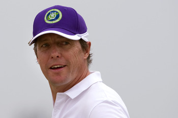 HAIKOU, CHINA - OCTOBER 31:  British actor Hugh Grant smiles on the 18th green during day five of the Mission Hills Start Trophy at Mission Hills Resort on October 31, 2010 in Haikou, China.  The Mission Hills Star Trophy is Asia's leading leisure liflest