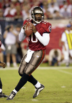 Tampa Bay Buccaneers quarterback Shaun King sets to pass during the second quarter August 23, 2003 at Raymond James Stadium, Tampa.  The Bucs defeated the Jacksonville Jaguars 10 - 6 in pre-season play  (Photo by Al Messerschmidt/Getty Images)