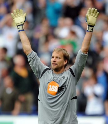 BOLTON, ENGLAND - MAY 07:  Jussi Jaaskelainen of Bolton Wanderers celebrates his side's first goal during the Barclays Premier League match between Bolton Wanderers and Sunderland at Reebok Stadium on May 7, 2011 in Bolton, England.  (Photo by Chris Bruns
