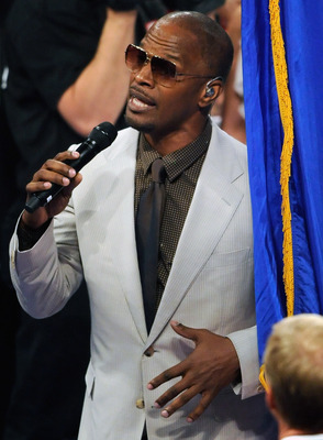 LAS VEGAS, NV - MAY 07:  Actor/singer Jamie Foxx sings, 'America the Beautiful' before the WBO welterweight title fight between Manny Pacquiao and Shane Mosley at the MGM Grand Garden Arena May 7, 2011 in Las Vegas, Nevada. Pacquiao retained his title in