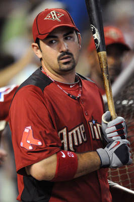 PHOENIX, AZ - JULY 12:  American League All-Star Adrian Gonzalez #28 of the Boston Red Sox looks on during batting practice before the start of the 82nd MLB All-Star Game at Chase Field on July 12, 2011 in Phoenix, Arizona.  (Photo by Norm Hall/Getty Imag