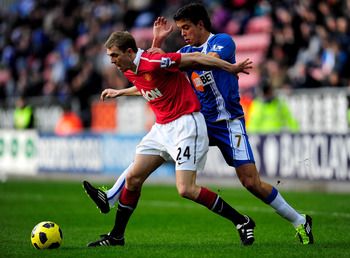 WIGAN, ENGLAND - FEBRUARY 26:  Franco Di Santo of Wigan Athletic battles for the ball with Darren Fletcher of Manchester United during the Barclays Premier League match between Wigan Athletic and Manchester United at the DW Stadium on February 26, 2011 in