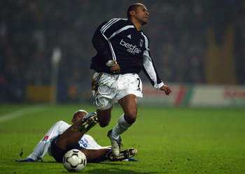LONDON - DECEMBER 12:  Steve Marlet of Fulham is fouled by a sliding tackle from Nene De Brito of Hertha Berlin during the UEFA Cup, third round, second leg match between Fulham and Hertha Berlin held on December 12, 2002 at Loftus Road in London England.