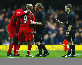 LONDON - JANUARY 7:  El Hadji Diouf (#9) of Liverpool appeals with the referee after he is sent off during the FA Barclaycard Premiership match between Chelsea and Liverpool at Stamford Bridge on January 7, 2004 in London.  (Photo by Ben Radford/Getty Ima