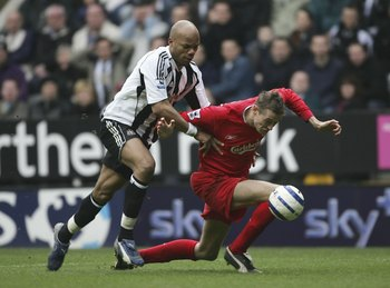 NEWCASTLE, ENGLAND - MARCH 19 : Jean Alain Boumsong of Newcastle United brings down Liverpool's Peter Crouch and gets sent off during the Barclays Premiership match between Newcastle United and Liverpool on March 19, 2006 in Newcastle, England.  (Photo by