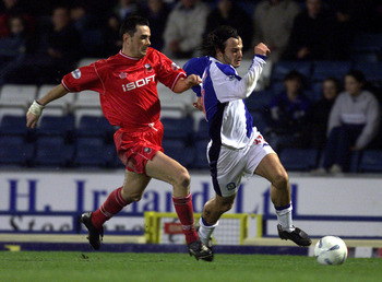 16 Jan 2002:  Corrado Grabbi of Blackburn battles with Steve Chettle of Barnsley during the Blackburn Rovers v Barnsley AXA FA Cup Third round replay at Ewood Park, Blackburn. DIGITAL IMAGE Mandatory Credit: Alex Livesey/Getty Images