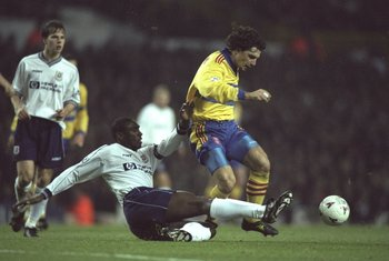 24 Nov 1997:  Sol Campbell (left) of Tottenham Hotspur slides in to tackle Michele Padovano of Crystal Palace during an FA Carling Premiership match at White Hart Lane in London. Crystal Palace won the match 1-0. \ Mandatory Credit: Stu  Forster/Allsport