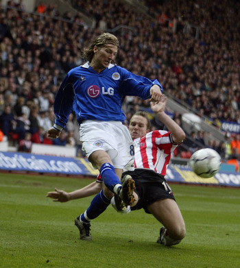 16 Mar 2002:  Robbie Savage of Leicester City clears the ball as Kevin Davies of Southampton goes in for the tackle during the FA Barclaycard Premiership match played at the St Mary's Stadium, in Southampton, England. The match ended in a 2-2 draw. DIGITA