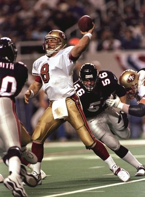 9 Jan 1999:  Quarterback Steve Young #8 of the San Francisco 49ers throws during the NFC Playoffs against the Atlanta Falcons at the Georgia Dome in Atlanta, Georgia. The Falcons defeated the 49ers 20-16. Mandatory Credit: Andy Lyons  /Allsport